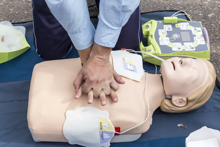 instructor showing cpr on training doll. first aid, cpr lessons